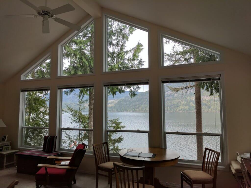 beach-front 2 bed home photo living area window overlooking Mabel Lake