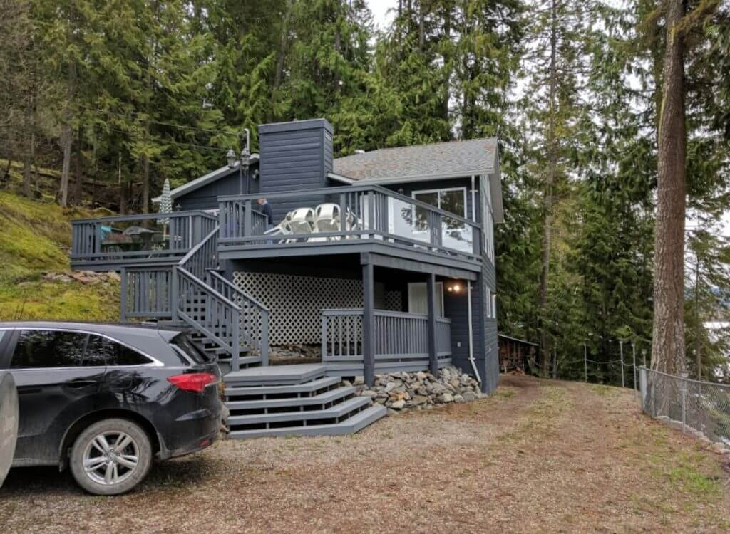 beach-front 2 bed home photo Mabel Lake home exterior with decks and staircases